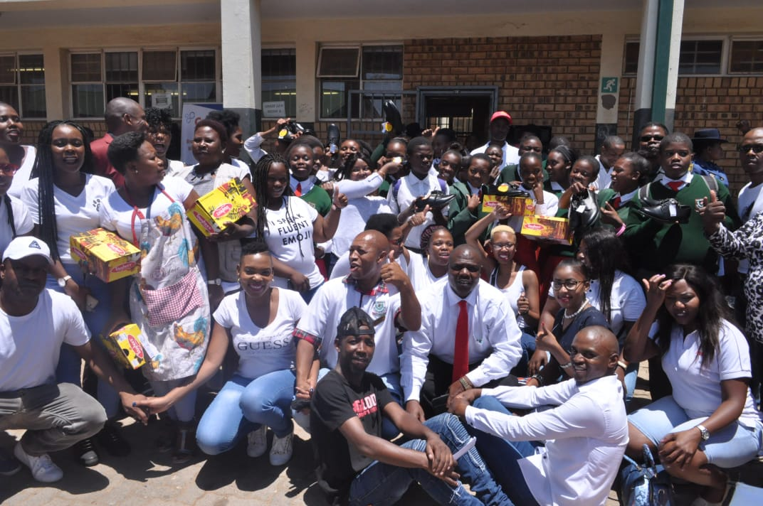 Former learners donate school shoes.