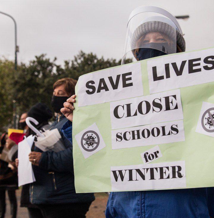 WHO entangles the D.O.E plans on schools.